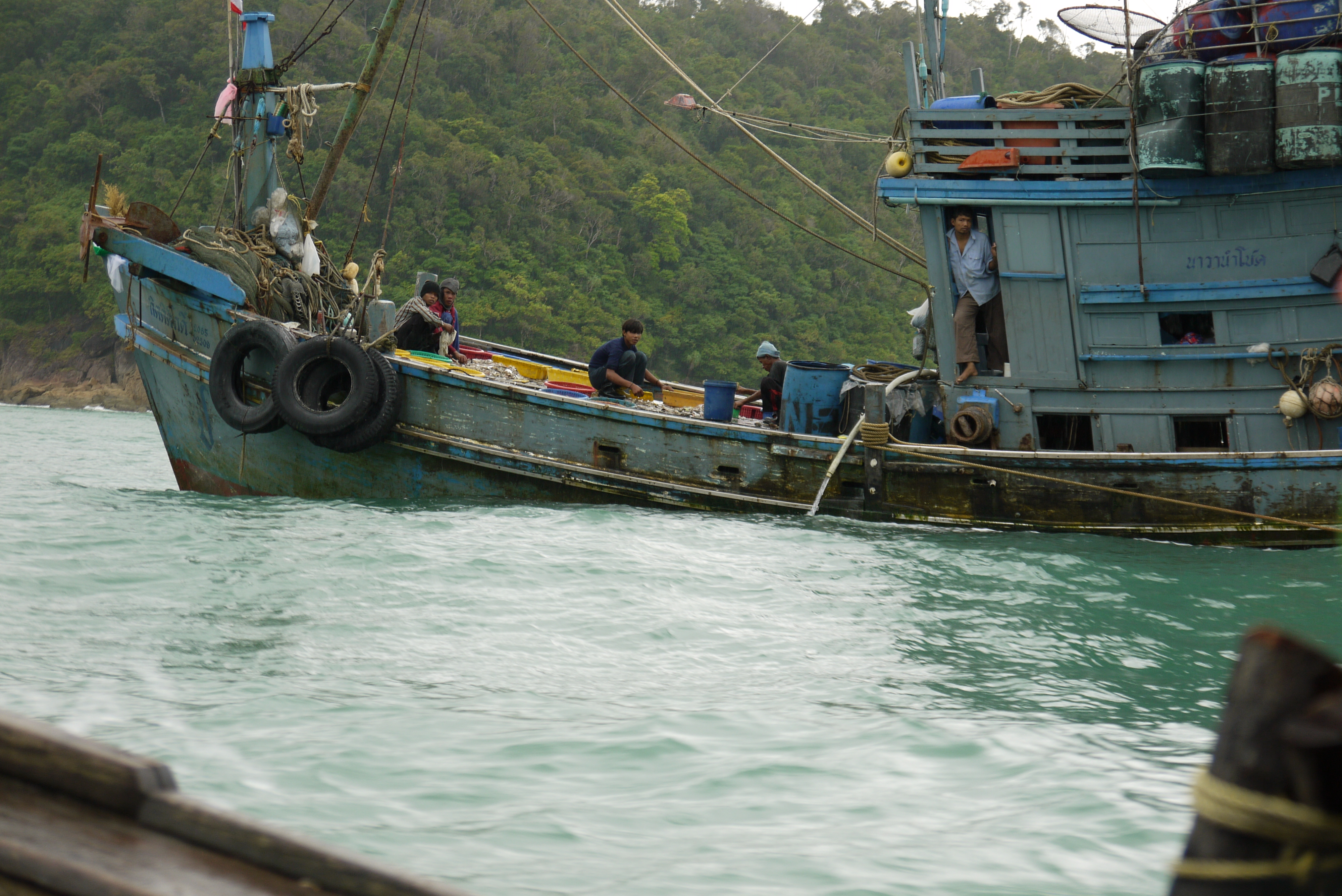 Migrant workers on a fishing boat on the Andaman coast of Thailand (Photo: Nathan Bennett)